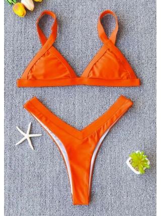 Яркий оранжевый купальник треугольник с плавками танга