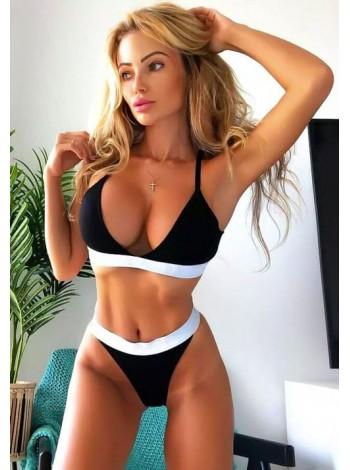 Черно-белый спортивный купальник на резинках